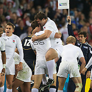England players Matt Banahan and Alex Corbisiero, (centre) celebrate at the final whistle after England's victory during the England V Scotland Pool B match during the IRB Rugby World Cup tournament. Eden Park, Auckland, New Zealand, 1st October 2011. Photo Tim Clayton...