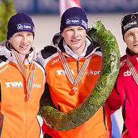 Netherlands' Jan Blokhuijsen (L), Netherlands' Sven Kramer (C) placed first and Norway's Havard Bokko (R) placed third celebrate their victory on the Speed Skating All-round European Championships in Budapest, Hungary on January 8, 2012. ATTILA VOLGYI