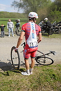 France, April 13th 2014: Team Katusha leader Alexander Kristoff (#61) waits for a replacement front wheel by the Pont Gibus during the 2014 Paris Roubaix cycle race.