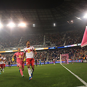 Tim Cahill, New York Red Bulls, runs to the corner flag to celebrate with his trademark corner flag punch after his 97th minute header leveled the scores at 2-2 during the New York Red Bulls V New England Revolution, Major League Soccer regular season match at Red Bull Arena, Harrison, New Jersey. USA. 5th October 2013. Photo Tim Clayton