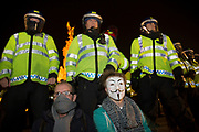 Riot police and protesters at Bonfire Night protest in central London by the activist group Anonymous, in a demonstration called the Million Mask March. Masked protesters created havoc as they marched on Parliament, and all over central London. The protest, which was organised in hundreds of cities, is said to be against austerity and infringement of human rights.