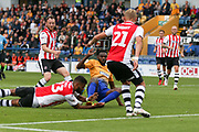 Luke Croll of Exeter City (23) and Dean Moxey of Exeter City (21) get a block in to stop a shot on target during the EFL Sky Bet League 2 match between Mansfield Town and Exeter City at the One Call Stadium, Mansfield, England on 15 September 2018.