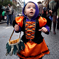 13-month old Mateya Foster, of Santa Cruz, is wide-eyed with amazement as she trick-or-treats dressed as a monarch butterfly along Pacific Avenue in downtown Santa Cruz, California.<br /> Photo by Shmuel Thaler <br /> shmuel_thaler@yahoo.com www.shmuelthaler.com