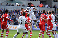 Swansea city's Wilfried Bony © wins a header. Barclays Premier league match, Swansea city v Southampton at the Liberty stadium in Swansea, South Wales on Saturday 3rd May 2014.<br /> pic by Andrew Orchard, Andrew Orchard sports photography.