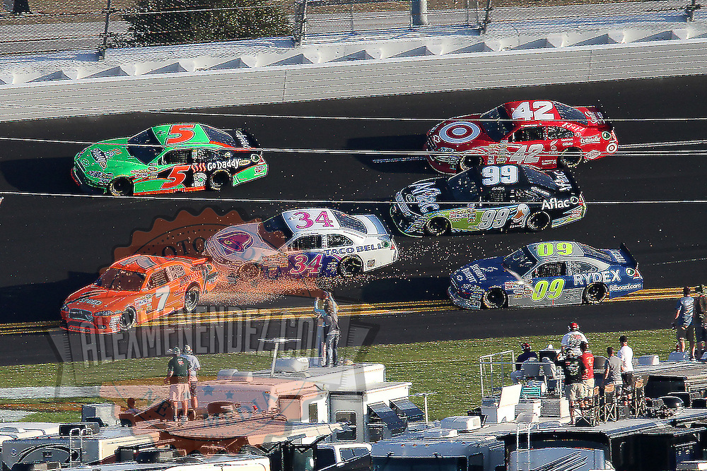 Sprint Cup Series driver Robby Gordon (7) loses control in turn 2  during the Daytona 500 at Daytona International Speedway on February 20, 2011 in Daytona Beach, Florida. (AP Photo/Alex Menendez)