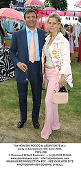 The HON.SIR ROCCO & LADY FORTE at a party in London on 16th June 2004.<br /> PWG 288