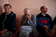 Patients in Soltanovka adult mental asylum in the Mogilev region of Belarus. Chernobyl's human costs are widespread affecting about seven million people.A generation later children are being born with birth defects ,heart problems and thyroid cancer.The crippled economy of Belarus has led to poverty, social problems and domestic abuse.