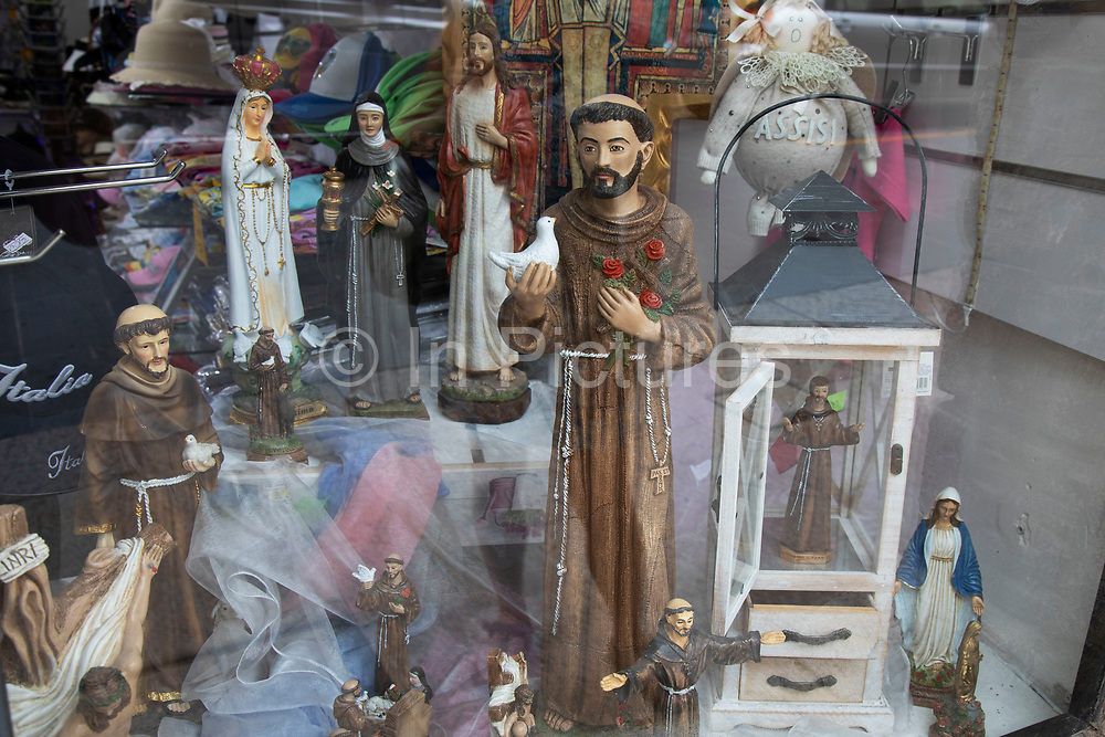 Figurines of St Francis of Assisi for sale as souvenirs in Assisi, Umbria, Italy. Saint Francis of Assisi, informally named as Francesco was an Italian Catholic friar, deacon and preacher. He founded the mens Order of Friars Minor, the women's Order of Saint Clare, the Third Order of Saint Francis and the Custody of the Holy Land. Francis is one of the most venerated religious figures in history and was designated Patron saint of Italy. He later became associated with patronage of animals and the natural environment. Assisi is a town in the Province of Perugia in the Umbria region, on the western flank of Monte Subasio. It is generally regarded as the birthplace of the Latin poet Propertius, and is the birthplace of St. Francis, who founded the Franciscan religious order in the town in 1208, and St. Clare, Chiara dOffreducci, the founder of the Poor Sisters, which later became the Order of Poor Clares after her death. Assisi is now a major tourist destination for those sightseeing or for more religious reasons.