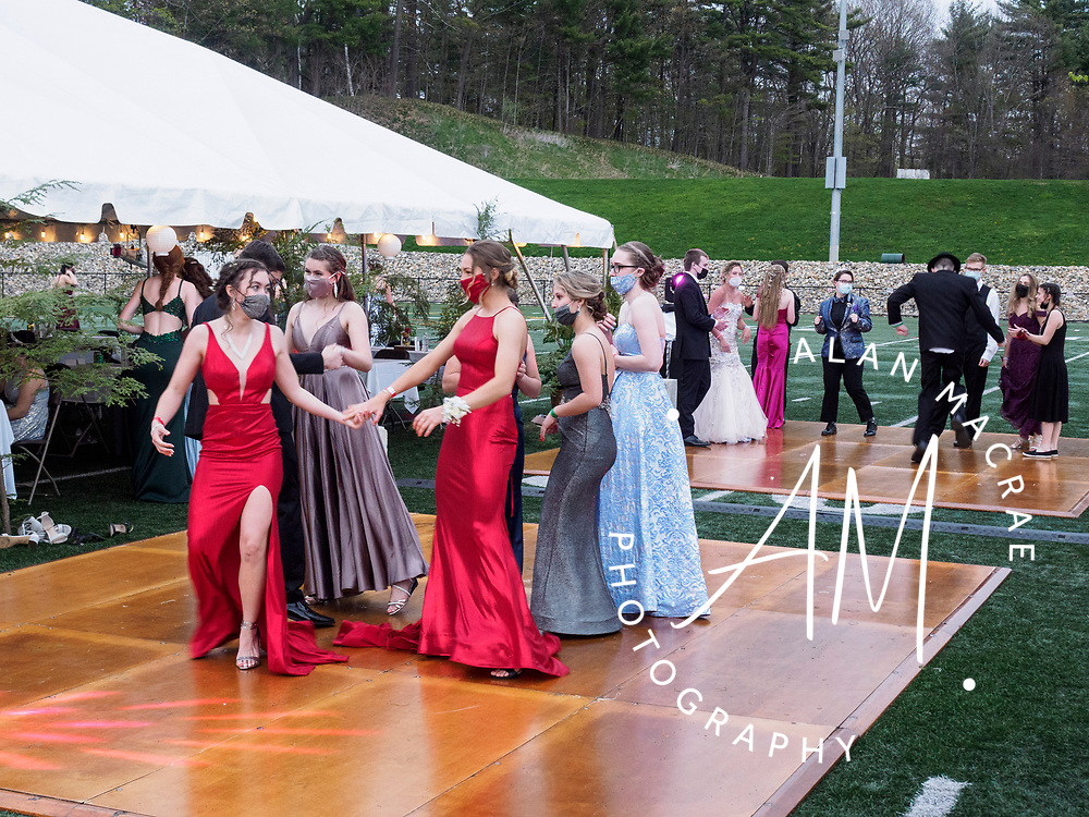Prom goers mix it up on the parquet set up on the turf field for Laconia High School's 2021 prom on Saturday May 8, 2021.(Alan MacRae photo/for the Laconia Daily Sun)