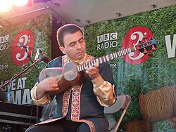 Azerbaijani band Gochag Askerov and ensemble playing at WOMAD 2009 - tar player