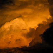 Turbulent clouds are illumated by the golden setting sun in the Caribbean.