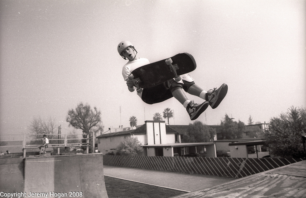 A skateboarder competes in a vert skateboarding contest on a half-pipe at the YMCA around the spring of 1988 in Visalia, California.
