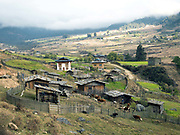 A small farm in the remote Phobjikha valley, Bhutan. At 2900 meters above sea level, Phobjikha Valley is one of the most important wildlife preserves in Bhutan due the large flock of the rare and endangered Black-necked Cranes that overwinters there.