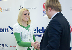 Sabina Veit and Peter Kukovica when Slovenian athletes and their coaches sign contracts with Athletic federation of Slovenia for year 2009,  in AZS, Ljubljana, Slovenia, on March 2, 2009. (Photo by Vid Ponikvar / Sportida)