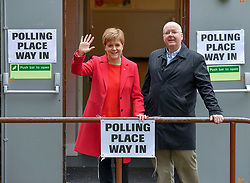 SNP leader Nicola Sturgeon and her husband Peter Murrell at her local polling station in Glasgow after casting her vote in the European elections.<br /> <br /> © Dave Johnston / EEm