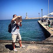 iPadographer. #crete #greece #tourism #tourist #sea #harbour #chania #street #water #man #holiday #hellas