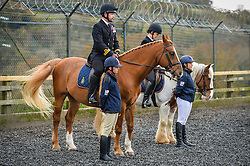 Royal Navy Officers observe prayers during the first ever memorial service dedicated to horses killed or injured in conflict, at the Royal Navy and Royal Marines Riding Stables at Bickleigh Barracks, Plymouth.