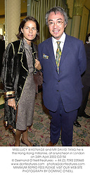 MISS LUCY WASTNAGE and MR DAVID TANG he is the Hong Kong millionire, at a luncheon in London on 24th April 2002.OZI 54
