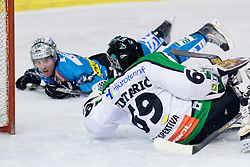 Reid Cashman (EHC Liwest Black Wings, #10) hits second post in a few seconds but Matija Pintaric (HDD Tilia Olimpija, #69) is still unbeaten during ice-hockey match between HDD Tilia Olimpija and EHC Liwest Black Wings Linz in 37th Round of EBEL league, on Januar 9, 2011 at Hala Tivoli, Ljubljana, Slovenia. (Photo By Matic Klansek Velej / Sportida.com)