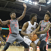 ORLANDO, FL - NOVEMBER 15: Chad Brown #21 of the UCF Knights gets fouled by David Efianayi #11 of the Gardner Webb Runnin Bulldogs as L'Hassane Niangane #31 looks on during a NCAA basketball game at the CFE Arena on November 15, 2017 in Orlando, Florida. (Photo by Alex Menendez/Getty Images) *** Local Caption *** Chad Brown; David Efianayi; L'Hassane Niangane
