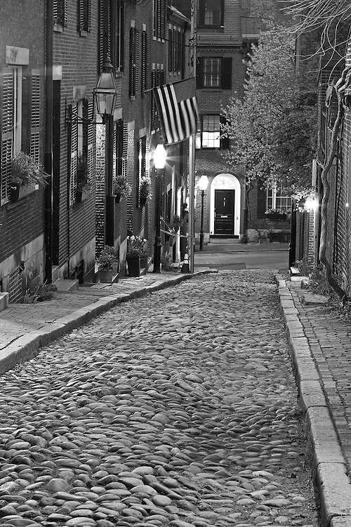 Black and White New England photography of the most photographed cobble stone street in Boston, Acorn Street. Acorn Street, often mentioned as the most frequently photographed street in the United States of America. It is a narrow lane paved with cobblestones that was home to coachmen employed by families in Mt. Vernon and Chestnut Street mansions.<br /> <br /> B&W Boston Beacon Hill Acorn Street photos are available as museum quality photography prints, canvas prints, acrylic prints or metal prints. Fine art prints may be framed and matted to the individual liking and decorating needs:<br /> <br /> http://juergen-roth.pixels.com/featured/boston-acorn-street-juergen-roth.html<br /> <br /> All Boston Black and White photos are available for digital and print image licensing at www.RothGalleries.com. Please contact me direct with any questions or request.<br /> <br /> Good light and happy photo making!<br /> <br /> My best,<br /> <br /> Juergen<br /> Prints: http://www.rothgalleries.com<br /> Photo Blog: http://whereintheworldisjuergen.blogspot.com<br /> Instagram: https://www.instagram.com/rothgalleries<br /> Twitter: https://twitter.com/naturefineart<br /> Facebook: https://www.facebook.com/naturefineart