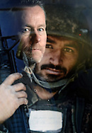 Friday 27 February 2015 to March 2016 <br /> National War Museum, Edinburgh Castle, Edinburgh<br /> <br /> ADMISSION FREE WITH ENTRY TO EDINBURGH CASTLE<br /> <br /> A new exhibition Helmand Return will open at the National War Museum in Edinburgh on Friday 27 February, showcasing the latest body of work from renowned photographer Robert Wilson. The exhibition documents British troops' final tour of Afghanistan and builds on his 2008 project Helmand: Faces of Conflict, which was exhibited at the National War Museum in 2009. <br /> <br /> In 2014 Wilson revisited Afghanistan as an official war artist, tasked with recording the British troops' final operational tour. The resulting exhibition offers a unique perspective on a much documented conflict, allowing a rare insight into the process of withdrawing from a war zone. In each of the pictures, Wilson captures the essence of the human and logistical challenges faced during the transfer of responsibility and withdrawal, including many never-before recorded sights both on and off base. Images include a soldier sculpting a metal rose from shrapnel for a loved one back home, intimate glimpses of life in the camp and beautifully composed portraits of the men and women preparing to head home.<br /> <br /> Pic Caption: Robert Wilson reflected through on of his portraits of an un-named Afghan National Army Trainee Officer.