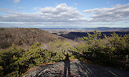 Mountainville, New York - Pitch pine (pinus rigida) cover the eastern ridge of Schunnemunk Mountain in a view from the Jessup Trail looking east toward the Hudson River on Nov. 28, 2010. The shadow of the photographer is at the lower center of the frame.