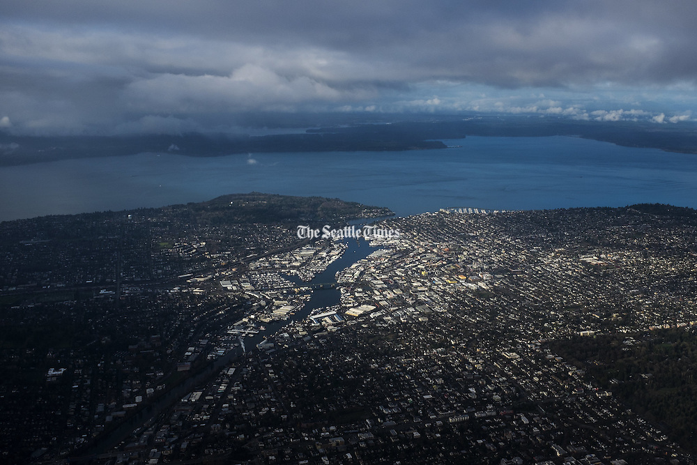 Aerial view of Ballard, the Ballard Locks and Magnolia looking west towards Puget Sound and the Olympics. (Bettina Hansen / The Seattle Times)