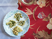 Fried Geranium leaves for lunch. Popi and Costas's house. In and around Meronas village, Central Crete.