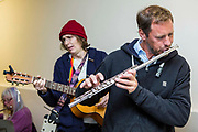 Members of the Wadebridge Streetband perform at the in the town hall. They are one of the community projects supported by the money raised from feed in tariffs at WREN community energy. Wadebridge, Cornwall. UK