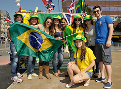 © Licensed to London News Pictures. 25/07/2012. Cardiff, Wales, UK.  Brazil fans arrive for the first event of the 2012 Olympics, the womens football match between Great Britain and New Zealand at the Millennium Stadium in Cardiff. Brazil play later this evening.  25 July 2012..Photo credit : Simon Chapman/LNP