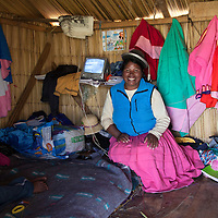 South America, Peru, Uros Islands. Inside a home on the floating reed islands of Lake Titicaca.