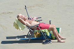 © Licensed to London News Pictures 14/06/2021. Folkestone, UK. The hot heatwave weather continues today in Kent as people enjoy Sunny Sands beach in Folkestone. Photo credit:Grant Falvey/LNP