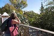 Female tourist enjoying the view of village of Arcos de la Frontera, Cadiz province, Spain
