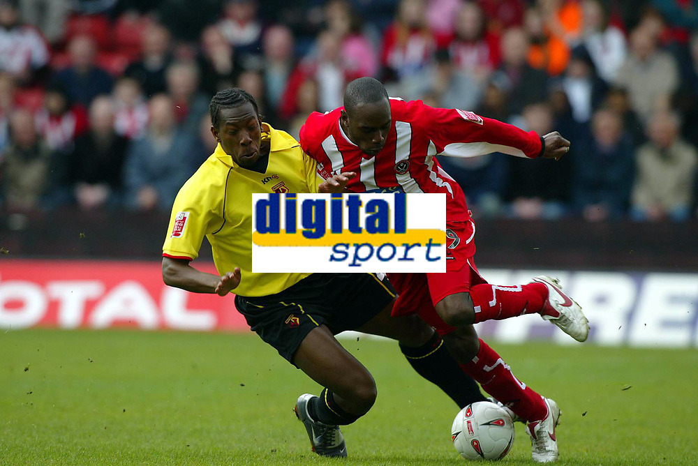 SPORTSBEAT 01494 783165<br /> PICTURE JAMES BOARDMAN<br /> WATFORD V SHEFFIELD UNITED<br /> 23RD APRIL 2005<br /> Watfords Lloyd Doyley and Steven Kabba clash  during there Nationwide Championship match at Vicarage Road, Watford.