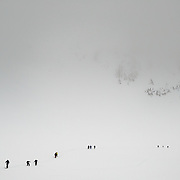 Droves of skiers head out of the Cascades after a weekend day of backcountry skiing.