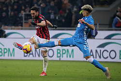 January 26, 2019 - Milan, Milan, Italy - Hakan Calhanoglu #10 of AC Milan competes for the ball with  Kevin Malcuit #2 of SSC Napoli during the serie A match between AC Milan and SSC Napoli at Stadio Giuseppe Meazza on January 26, 2018 in Milan, Italy. (Credit Image: © Giuseppe Cottini/NurPhoto via ZUMA Press)