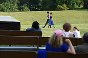 TIVOLI, NY - AUG 2:  Dancers Calvin Royal III, left, and Courtney Lavine, right, walk through a field toward the stage for their performances at the,Kaatsbaan International Dance Center's Summer Festival, Sunday, Aug. 2, 2020, in Tivoli, New York. (Photo by Jessica Hill for the Washington Post)