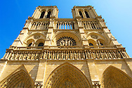 """Paris - France - Notre Dame - Front with Sataues and Towers . Notre-Dame de Paris, meaning """"Our Lady of Paris"""", referred to simply as Notre-Dame, is a medieval Catholic cathedral on the Île de la Cité. The Notre-Dame cathedral was consecrated to the Virgin Mary and considered to be one of the finest examples of French Gothic architecture. Notre-Dame's pioneering use of the rib vault and flying buttress, its enormous and colourful rose windows, as well as the naturalism and abundance of its sculptural decoration..<br /> <br /> Visit our MEDIEVAL PHOTO COLLECTIONS for more   photos  to download or buy as prints https://funkystock.photoshelter.com/gallery-collection/Medieval-Middle-Ages-Historic-Places-Arcaeological-Sites-Pictures-Images-of/C0000B5ZA54_WD0s"""