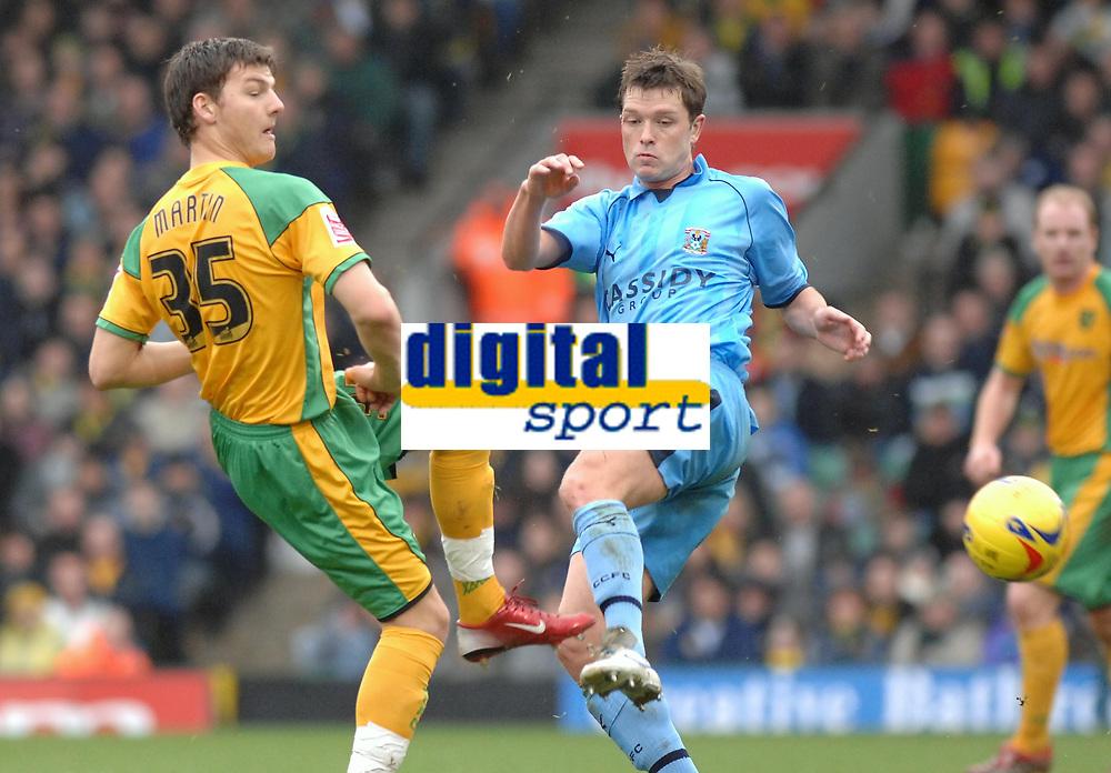 Photo: Ashley Pickering.<br />Norwich City v Coventry City. Coca Cola Championship. 24/02/2007.<br />Norwich goal scorer Chris Martin (L) and Stephen Hughes of Coventry