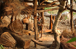 "RUKUM DISTRICT, NEPAL, APRIL 17, 2004:  A child sits insie a wheat mill in Rukum District April 17, 2004.  Many children are regulalry kidnapped by Maoists in order to eucate them about the movement. Analysts and diplomats estimate there about 15,000-20,000 hard-core Maoist fighters, including many women, backed by 50,000 ""militia"".  In their remote strongholds, they collect taxes and have set up civil administrations, and people's courts. They also raise money by taxing villagers and foreign trekkers.  They are tough in Nepal's rugged terrain, full of thick forests and deep ravines and the 150,000 government soldiers are not enough to combat this growing movement that models itself after the Shining Path of Peru. (Ami Vitale/Getty Images)"