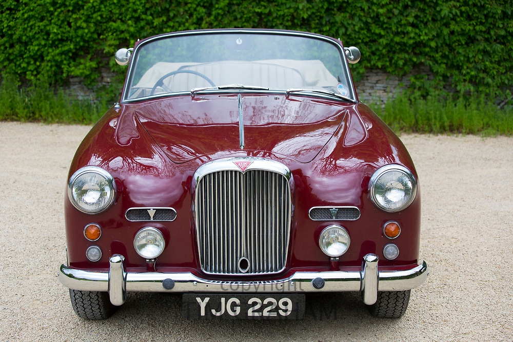 British made Alvis TD21 DHC Series 1 drophead coupe classic car - colour Peony - parked in The Cotswolds, England
