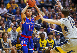 Jan 19, 2019; Morgantown, WV, USA; Kansas Jayhawks guard Devon Dotson (11) looks to pass during the first half against the West Virginia Mountaineers at WVU Coliseum. Mandatory Credit: Ben Queen-USA TODAY Sports