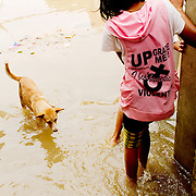 Young girl at Mandalay flooded street
