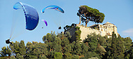 Portofino . Castle Brown. Paragliders.  Italy .<br /> <br /> Visit our ITALY HISTORIC PLACES PHOTO COLLECTION for more   photos of Italy to download or buy as prints https://funkystock.photoshelter.com/gallery-collection/2b-Pictures-Images-of-Italy-Photos-of-Italian-Historic-Landmark-Sites/C0000qxA2zGFjd_k