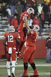 11 December 2015:  Ryan Gelber(56) and Christian Gibbs(12) joins Anthony Warrum(82) in the end zone to celebrate the touchdown by Anthony Warrum(82). NCAA FCS Quarter Final Football Playoff game between Richmond Spiders and Illinois State Redbirds at Hancock Stadium in Normal IL (Photo by Alan Look)