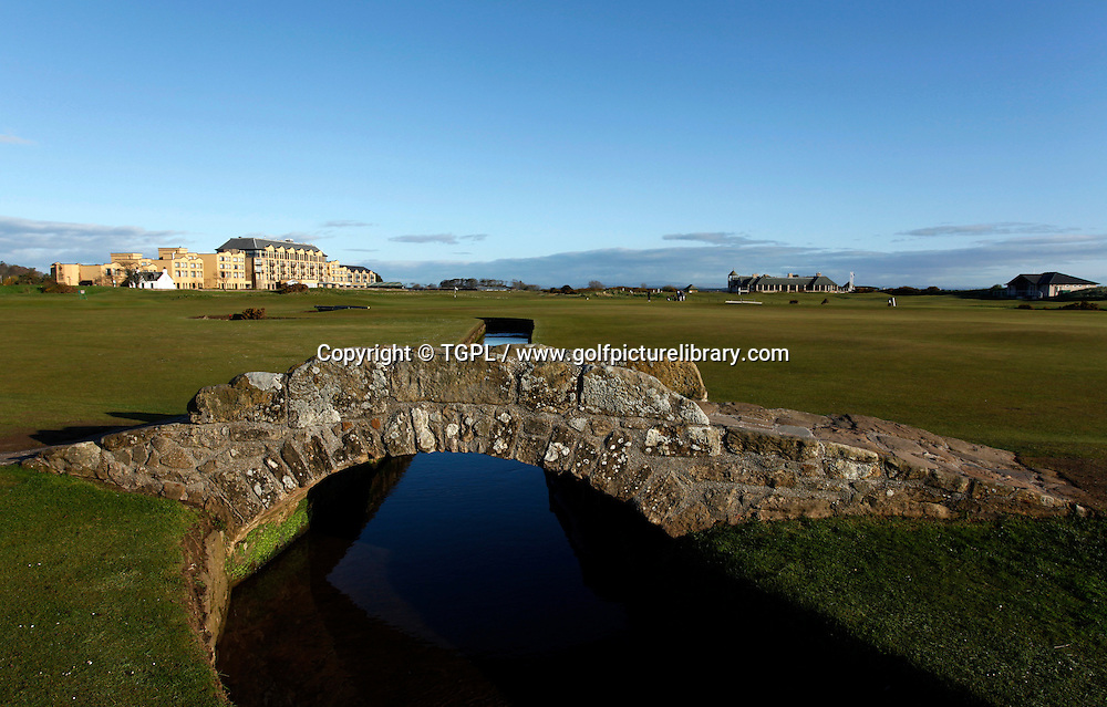 The famous Swilken Bridge that crosses part of the final hole,18th par 4, at ST.ANDREWS Old Course,St.Andrews,Fife,Scotland.The 1st par 4 green is in the background.