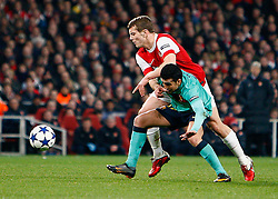 16.02.2011, Emirates Stadium, London, ENG, UEFA CL, FC Arsenal vs FC Barcelona, im Bild Barcelona's Xavi (1? vice-captain)  with Arsenal's Jack Wilshere   in Arsenal vs Barcelona for the UCL  ,Round of last 16, at the Emirates Stadium in London on 16/02/2011, EXPA Pictures © 2011, PhotoCredit: EXPA/ IPS/ Kieran Galvin +++++ ATTENTION - OUT OF ENGLAND/GBR and France/ FRA +++++