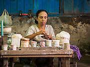 10 NOVEMBER 2014 - SITTWE, MYANMAR: A betel vendor makes betel packets in the market in Sittwe. Sittwe is a small town in the Myanmar state of Rakhine, on the Bay of Bengal.    PHOTO BY JACK KURTZ