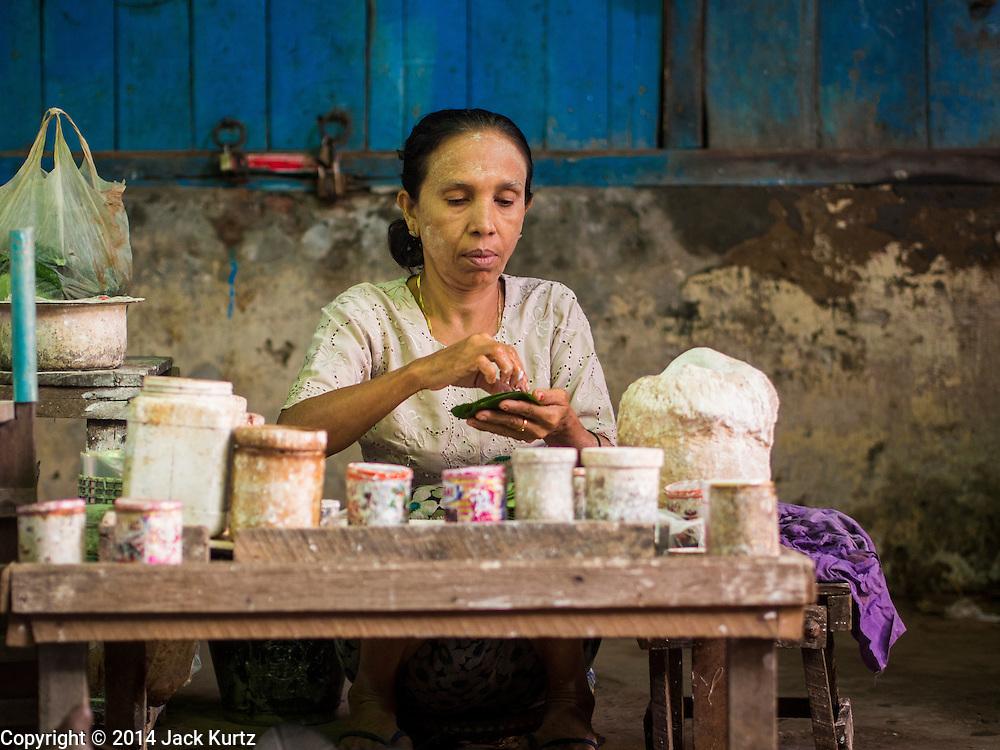 10 NOVEMBER 2014 - SITTWE, MYANMAR: A betel vendor makes betel packets in the market in Sittwe. Sittwe is a small town in the Myanmar state of Rakhine, on the Bay of Bengal.    PHOTO BY JACK KURTZ
